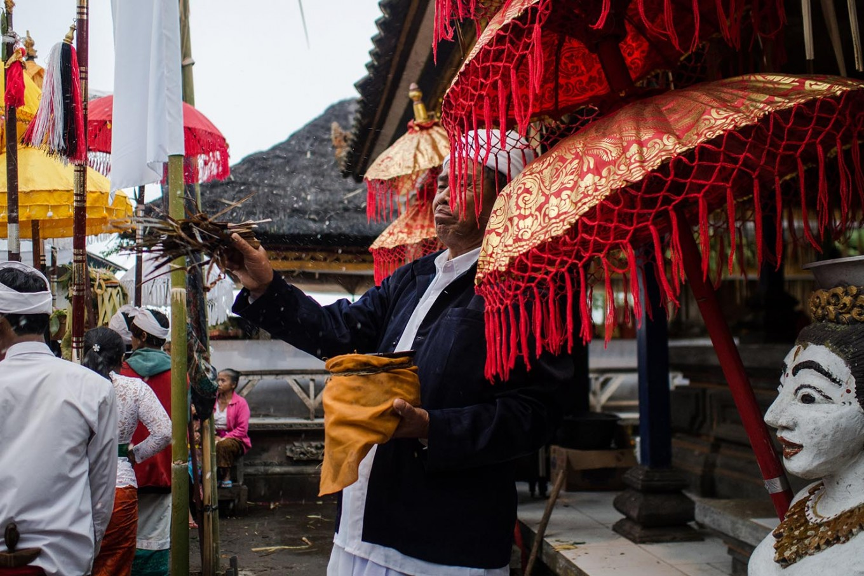 A Hindu priest performs a ritual involving water. JP/Anggara Mahendra