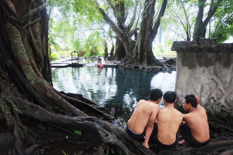 Visitors at Umbul Kapilaler in Klaten, Central Java.