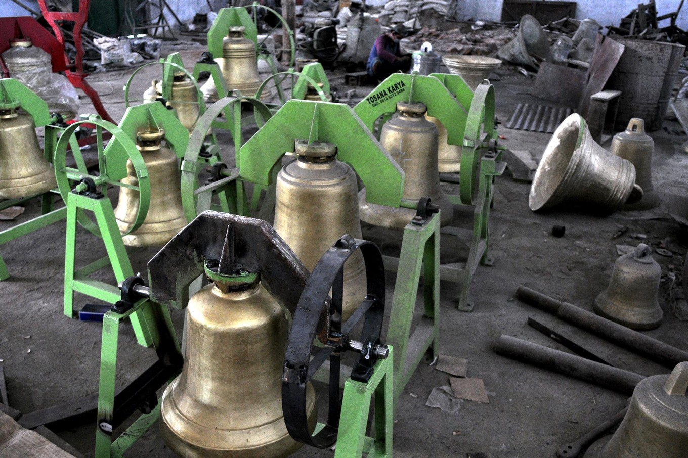 Church bells in different sizes are displayed and ready for delivery to customers. JP/Magnus Hendratmo