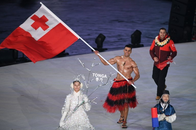 Tongan goes topless again at Olympics -- in icy cold