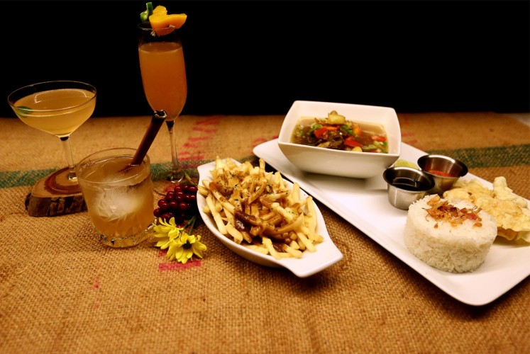 Signature dishes at Beer Garden SCBD include Bourbon Legend, Lychee Basil, Peach Spritzer, Oxtail Soup and Pommes Poutine.