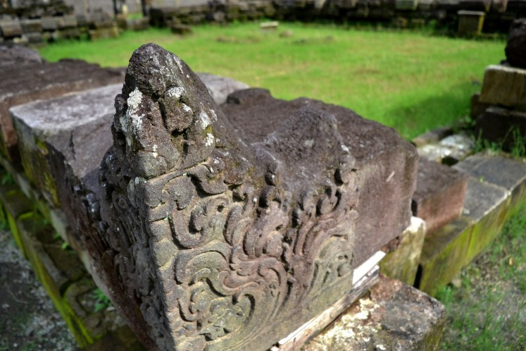 A close-up shot reveals the carvings on a stone block of the Kedulan Temple, which will be reunited with the rest of the stone blocks in reconstructing the temple.