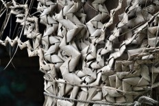 An installation of dried coconut leaf webbing symbolizes rain as a blessing for all creatures. JP/Magnus Hendratmo