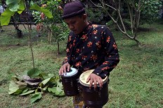 A percussion player from the Kentrung Rock N Roll Solo community practices before performing the Nyi Ageng Serang arrangement. The site where Nyi Ageng Serang fought against Dutch colonialism decades ago is now the Kedung Ombo dam in Purwodadi, Central Java. JP/Magnus Hendratmo
