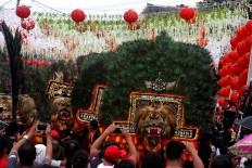 Bring it on: A dance troupe walks past Chinese lanterns.  JP/ Maksum Nur Fauzan
