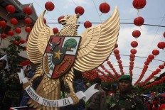 "National interest: The country's national emblem, the Garuda Pancasila, carries the Sanskrit motto ""Bhinneka Tunggal Ika"" (Unity in Diversity). JP/ Maksum Nur Fauzan"