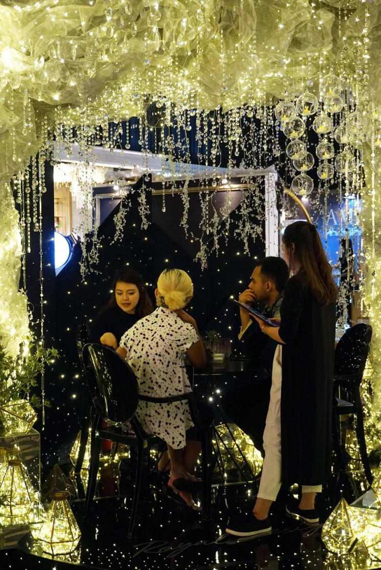 Sparkling: Colorful lights set the mood at this year's Bridestory Fair in line with its theme, 'Stardust', at the Sheraton Hotel's grand ballroom in Jakarta.