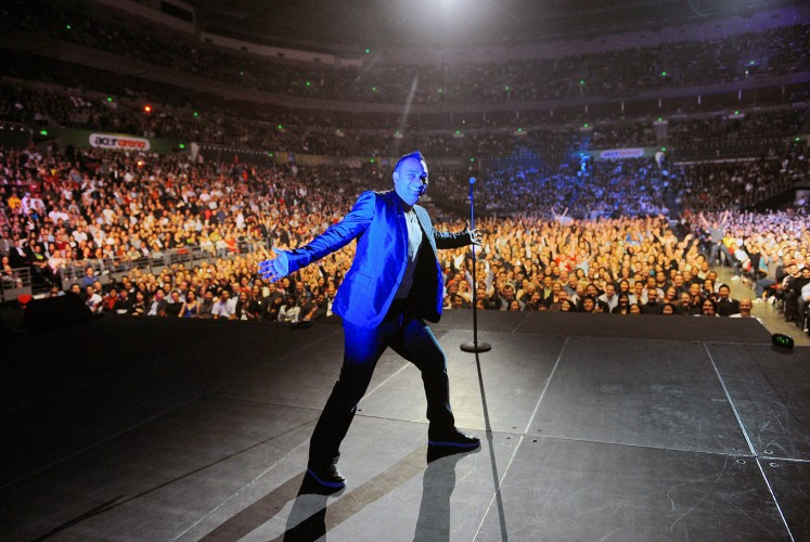 Jam-packed: Russell Peters performs at Acer Arena, meanwhile renamed Allphones Arena, in Sydney, Australia, back in 2010.