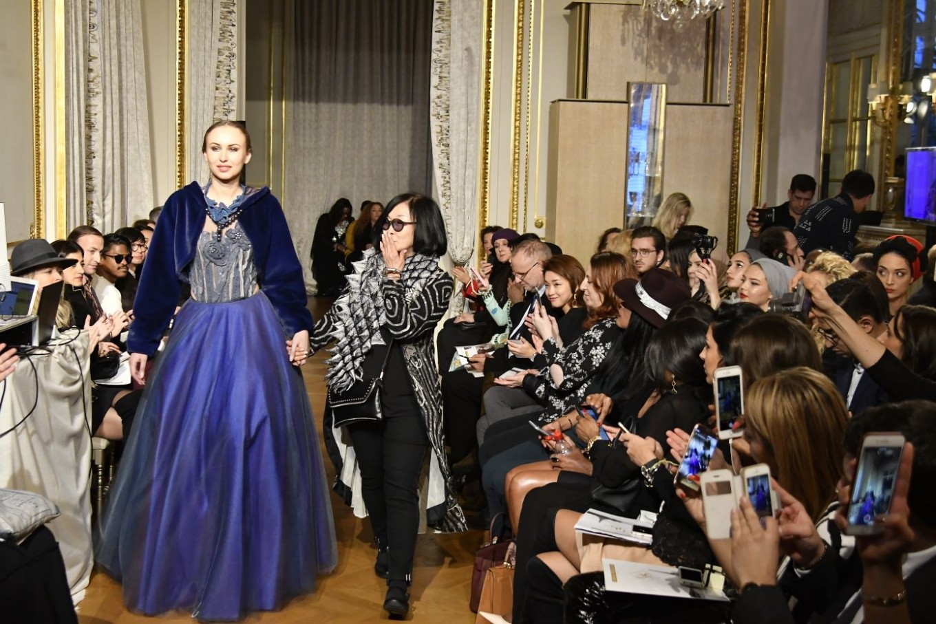 Indonesian designer Ika Butoni and one of the models presenting her creations appear at the Oriental Fashion Show in Paris on Jan. 25.