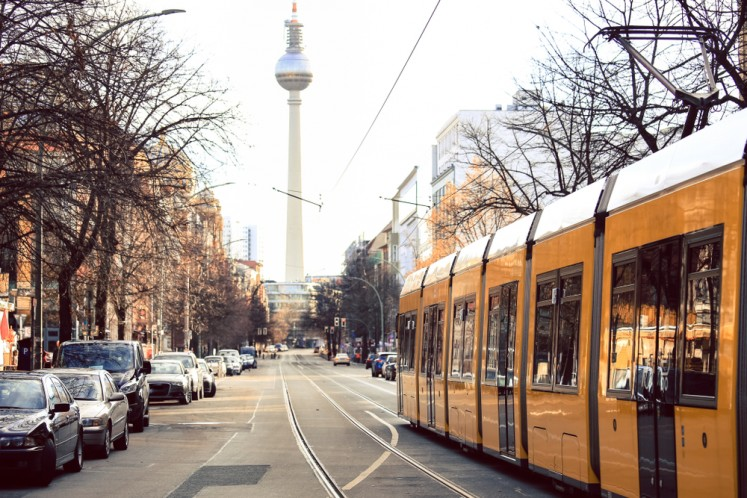 Yellow public transportation tram passing through the city of Berlin, Germany.