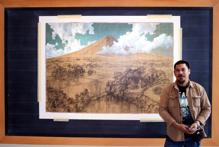 Shaping perceptions: Artist Jumaldi Alfi poses in front of his painting Melting Memories, Rereading Landscape, Mooi Indies #03 ( 2013 ) on Feb. 6.