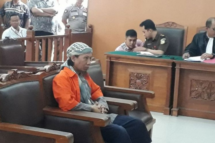 Aman Abdurrahman (center), the alleged mastermind of the Jan. 14, 2016 suicide bombings and gun attacks on Jl. MH Thamrin, Central Jakarta, during a court hearing in South Jakarta District Court on Feb. 15.