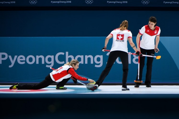 Switzerland's Silvana Tirinzoni throws the stone during the women's curling round robin session between the Olympic Athletes from Russia and Switzerland during the Pyeongchang 2018 Winter Olympic Games on Feb. 19, 2018.