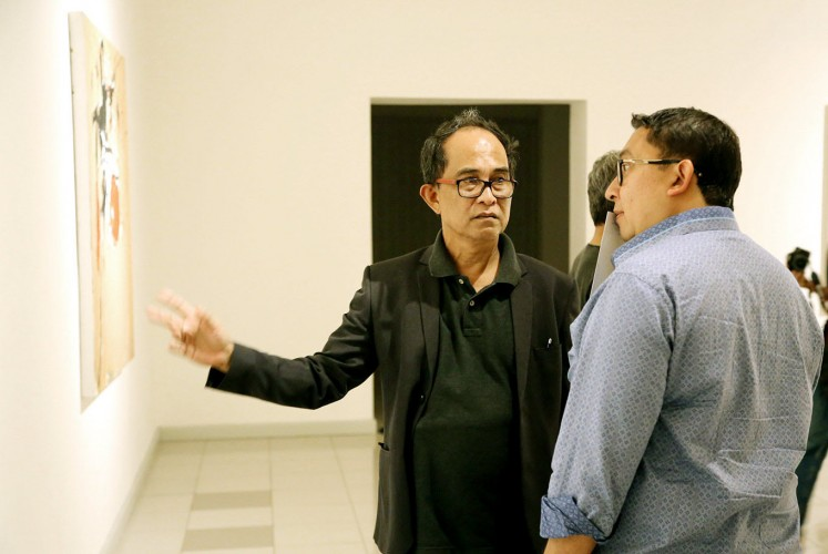 Meet the collector: Painter Yoes Rizal (left) chats during his solo exhibition opening with House of Representatives Deputy Speaker Fadli Zon from the Gerindra Party at the National Gallery. Fadli is a well-known enthusiastic art collector.