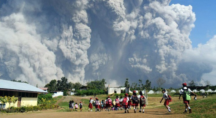 Villages covered in ash as Mount Sinabung erupts