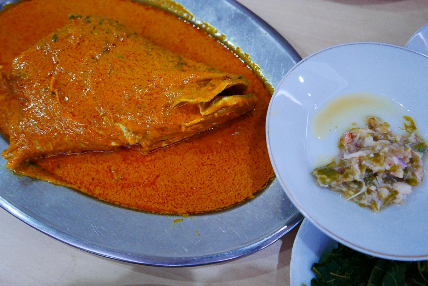 Fish head curry is the signature dish of the Medan Baru restaurant.