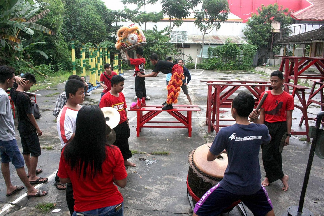 Gathering: Barongsai group members gather around during their practice session. JP/ Maksum Nur Fauzan
