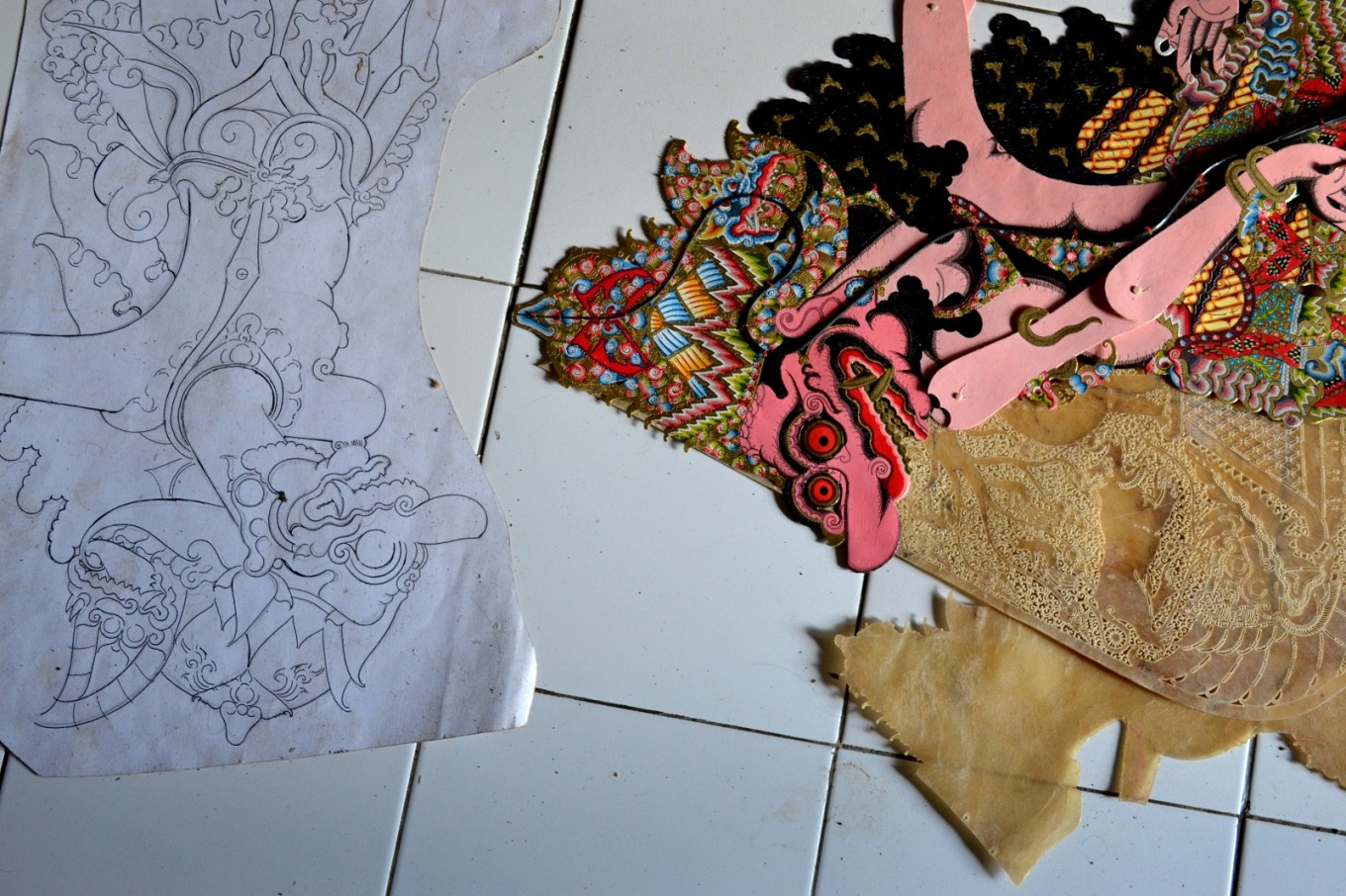 The process of making 'wayang kulit' starts from an early sketch on paper.