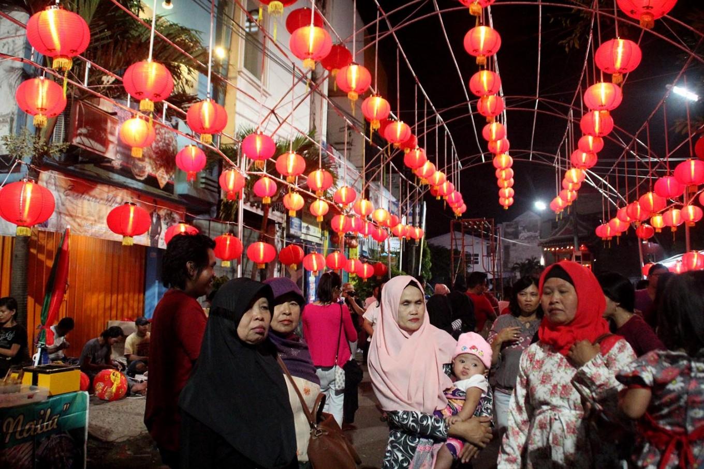 A Muslim family walks through the Semawis Imlek Night Market. The night market this year was held from Feb. 12-14. JP/Suherdjoko