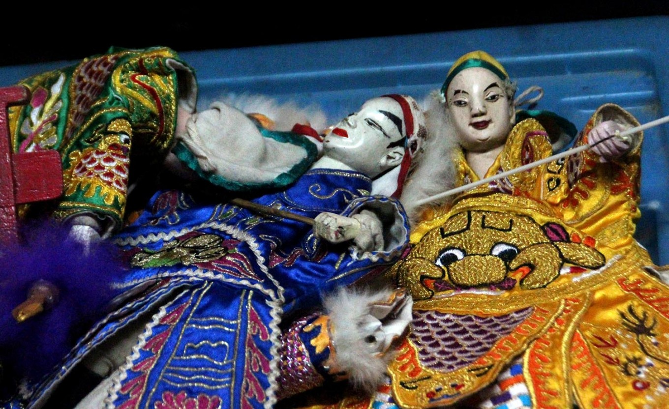 Dolls are arranged neatly before the Potehi puppet show begins. JP/Suherdjoko