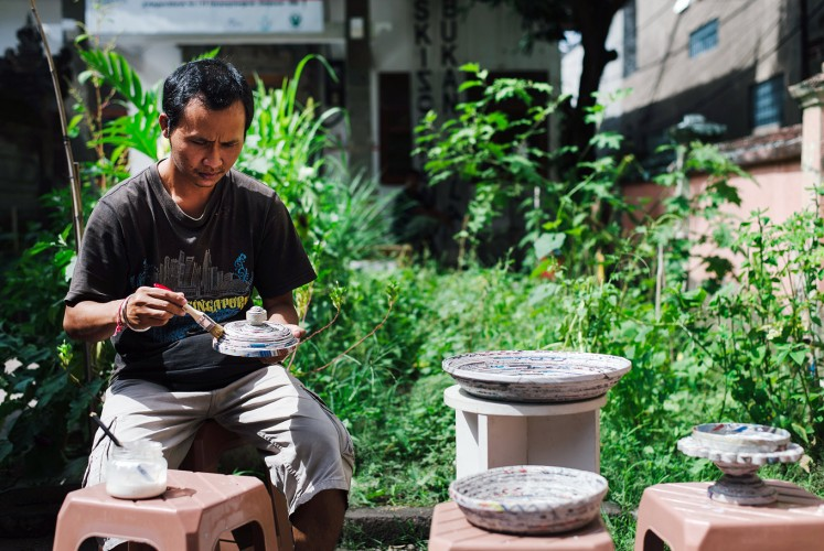 Upcycle: A Rumah Berdaya activist demonstrates how to make trays using recycled papers.