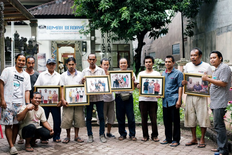 Family support: Rumah Berdaya activists and participants pose with their family portraits.