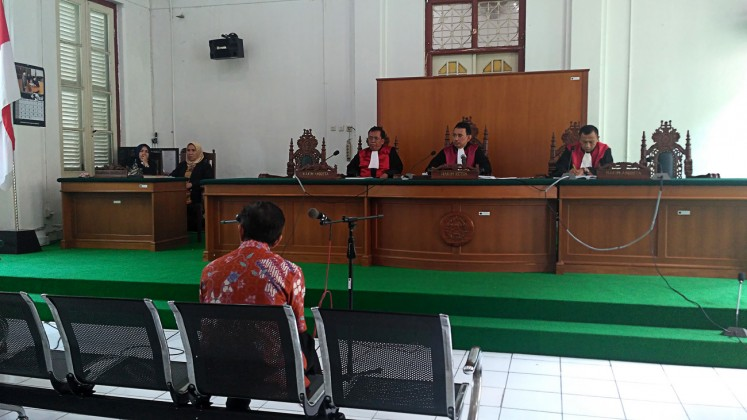 Disgraced: Former Takalar regent Burhanuddin Baharuddin attends his first graft trial at the Makassar Corruption Court in Makassar, South Sulawesi, on Feb.22.