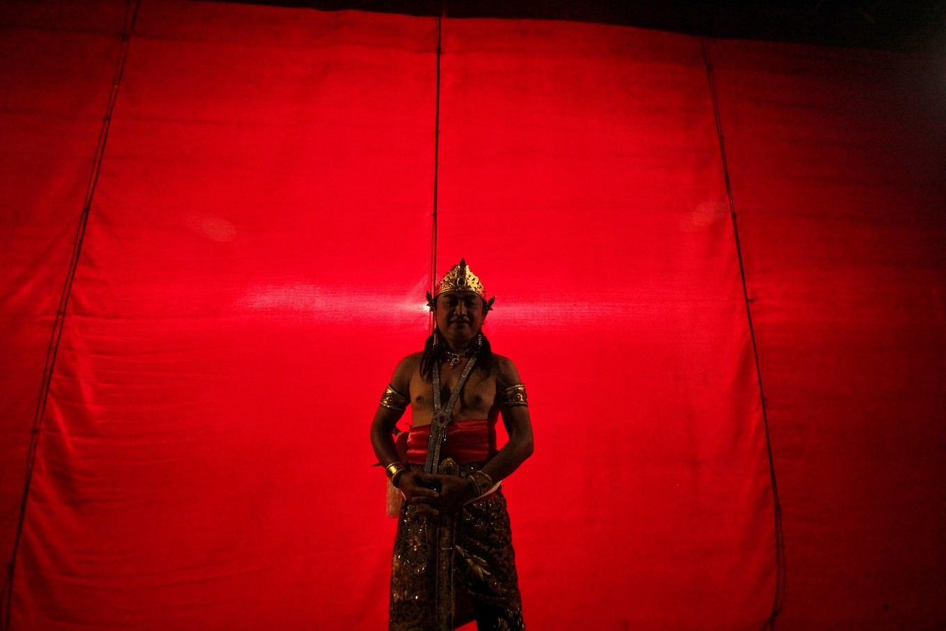 An actor who plays the character of Arjuna poses in between the show. JP/Aditya Sagita