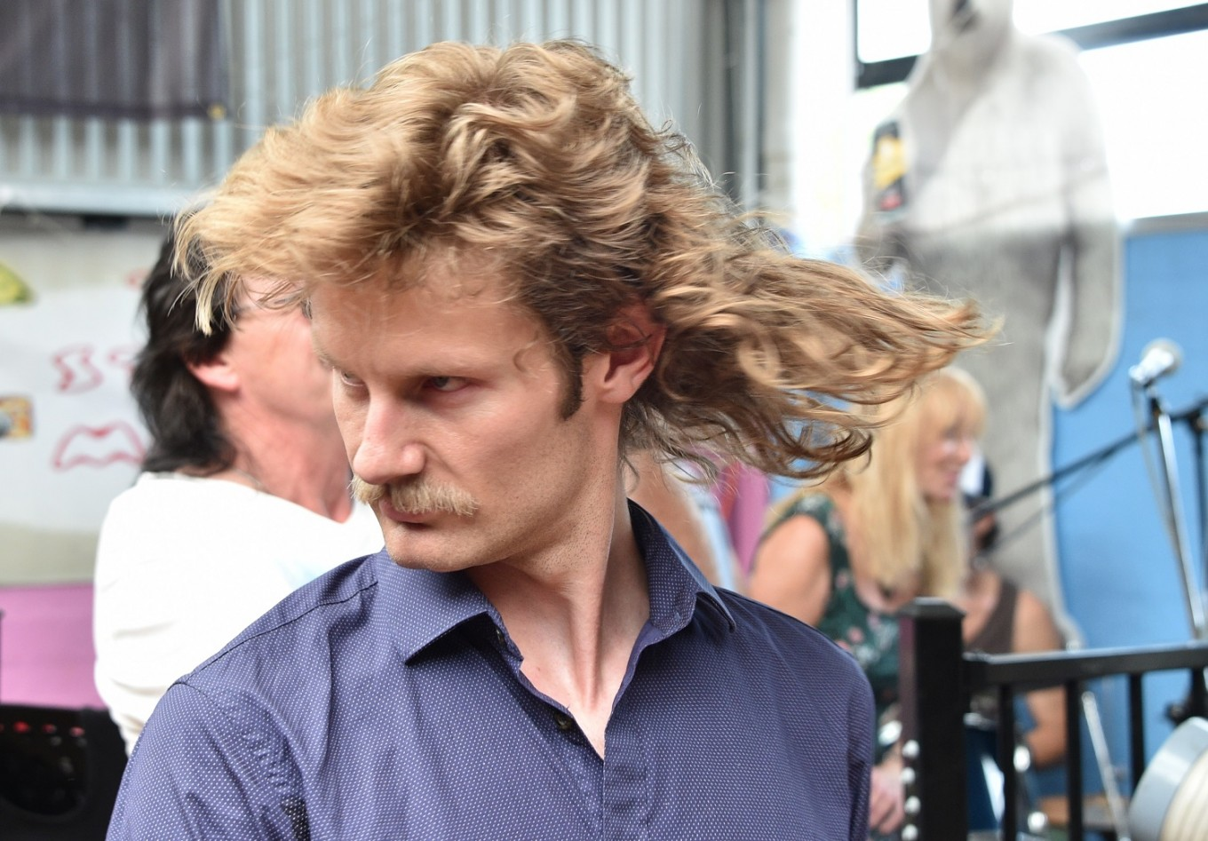 A man shows off his mullet haircut at Mulletfest 2018 in the town of Kurri Kurri, 150 kilometers north of Sydney on February 24, 2018. Mulletfest is a celebration of the iconic haircut called the mullet which began in the 1970s and popular in the 1980s, and making a comeback in Australia.