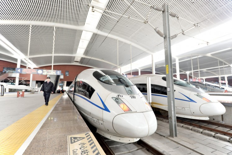 Super fast: A high speed train from Harbin to Qiqihar waits to pull out of the train station in Harbin, northeast China's Heilongjiang province.