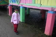 A student walks to class. JP/Maksum Nur Fauzan