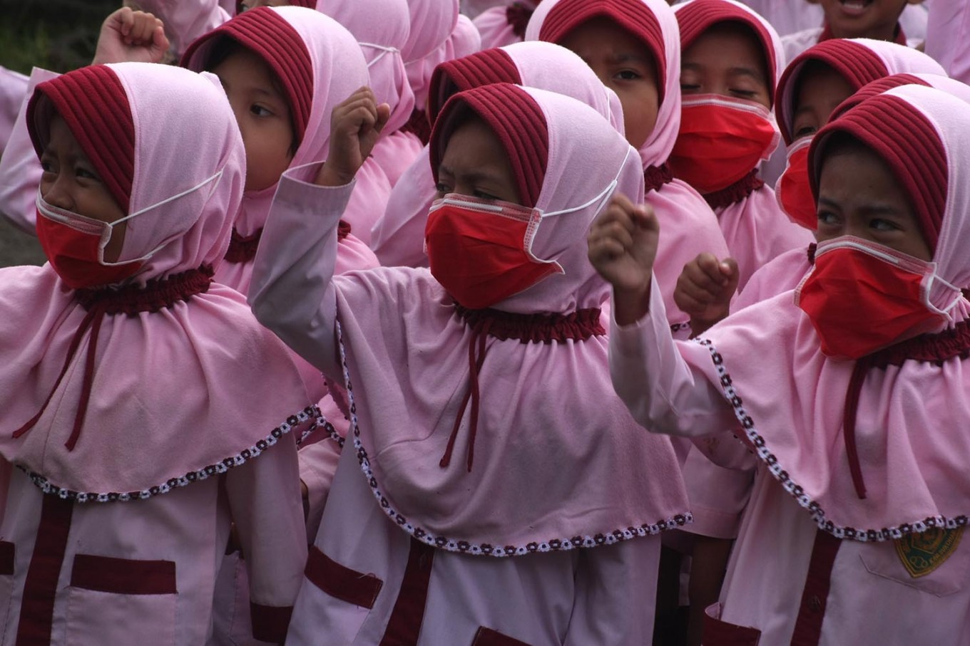Female students attend physical education class while still wearing their surgical masks. JP/Maksum Nur Fauzan