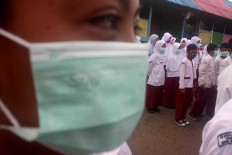 Surgical masks for students and teachers are provided by the school.  JP/Maksum Nur Fauzan