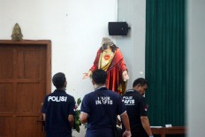 Beheaded: Police officers inspect the statue of Jesus at St. Lidwina Church in Bedog, Sleman, Yogyakarta on Sunday, February 11. A man attacked the church using a sword during mass, injuring several people, including the pastor. JP/Aditya Sagita