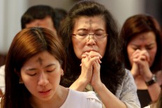 Catholics pray after receiving ash on their foreheads during an Ash Wednesday Mass at Santo Petrus Cathedral in Bandung February 14. JP/Arya Dipa