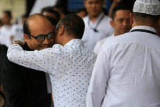Welcome back: A colleague hugs Corruption Eradication Commission (KPK) senior investigator Novel Baswedan at the KPK office in Jakarta after arriving from Singapore on Thursday, February 22.
