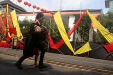 A man carries a female dancer who fainted while performing. JP/Maksum Nur Fauzan