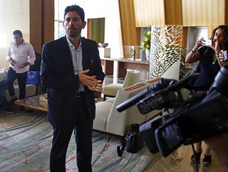 Orestes Fintiklis, managing partner of Ithaca Capital Partners, which now owns the hotel and the majority of the condo units at the Trump International Hotel & Tower speaks with journalist in the hotel's lobby in Panama City on March 5, 2018.