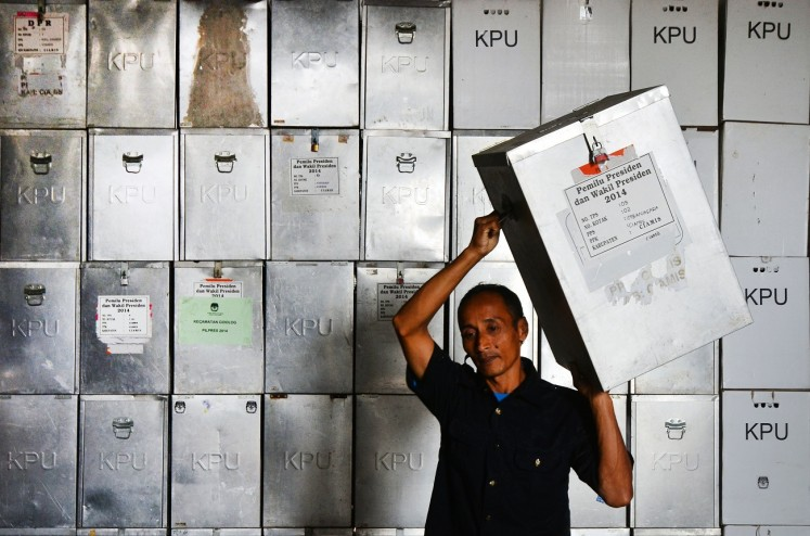 An election officer moves a ballot box from the Ciamis Regional Elections (Pilkada) logistics warehouse in Ciamis regency, West Java, on Feb.28.