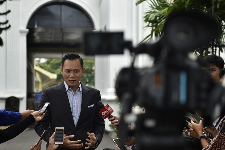 All set: Democratic Party executive Agus Harimurti Yudhoyono talks to journalists after his meeting with President Joko