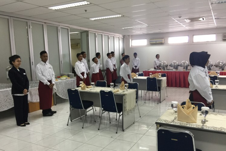 Samantha (left) poses alongside other participants of ART Hospitality during a practice event on Jan. 13 in North Jakarta.
