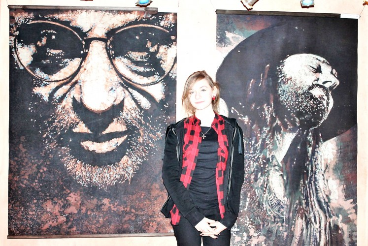 Up close: A woman stands in front of batik portraits of jazz musicians created by Polish teenagers from the Przasnysz Art Center in Przasnysz, a small town in north-eastern Poland. The portraits were made in 2015.