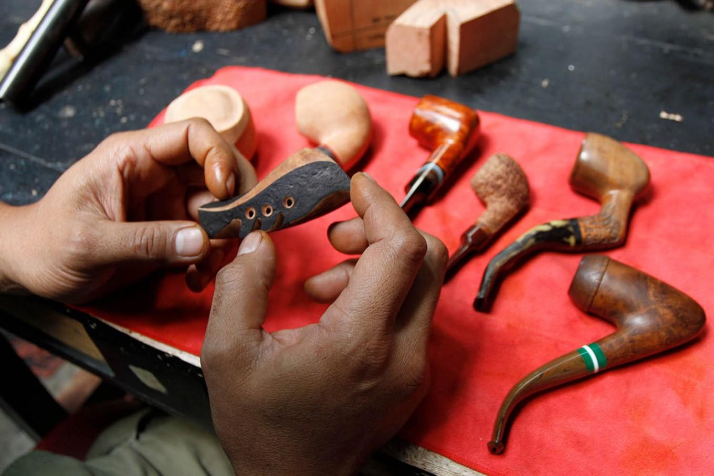 Edy smoothens a tobacco pipe. JP/Arya Dipa