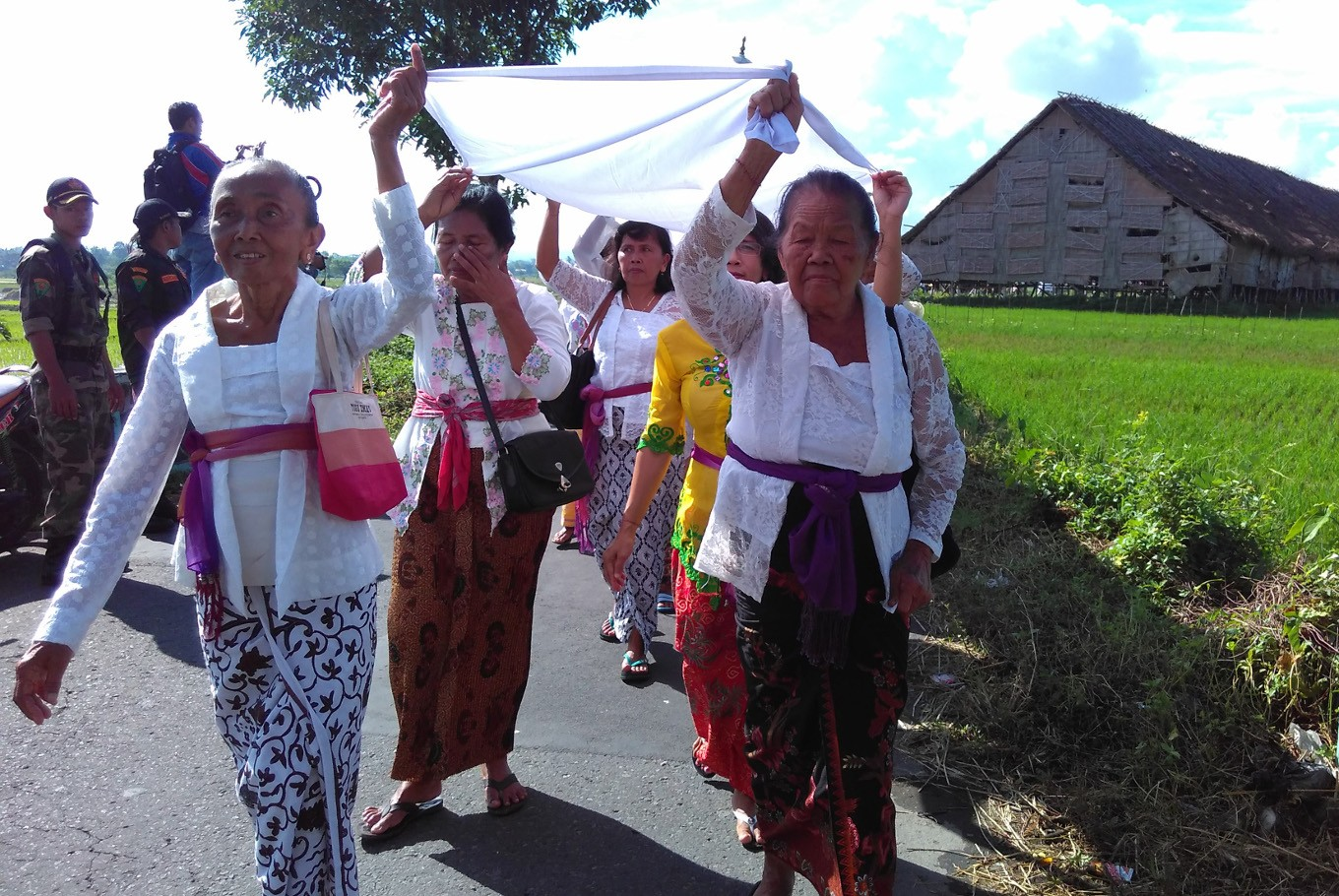 Some of the participants of Melasti walk to reach Umbul Geneng in Klaten, Central Java, on Sunday, March 11.