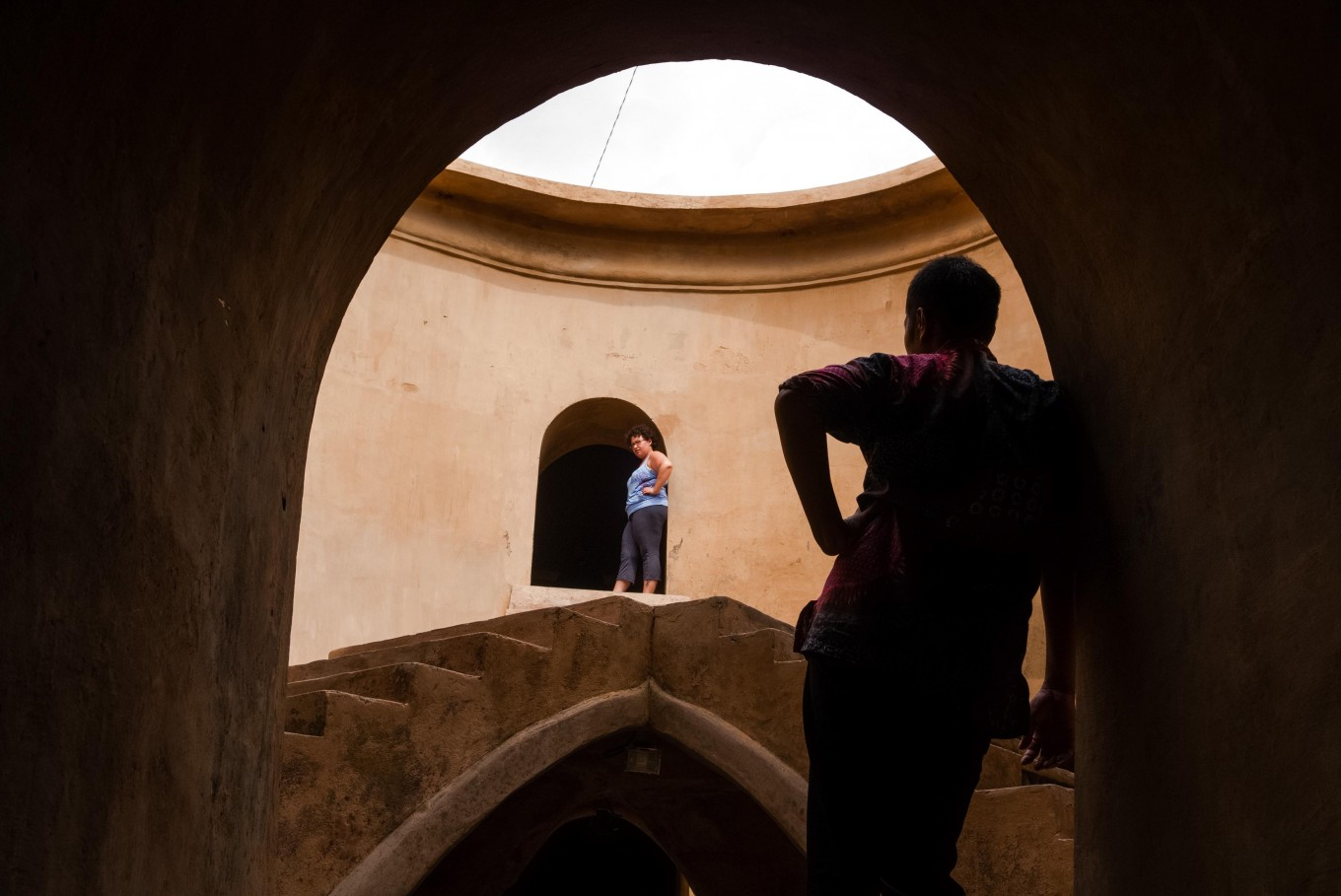 Looking up: Tourists take a look around Sumur Gumuling Mosque in Yogyakarta. JP/ Anggara Mahendra
