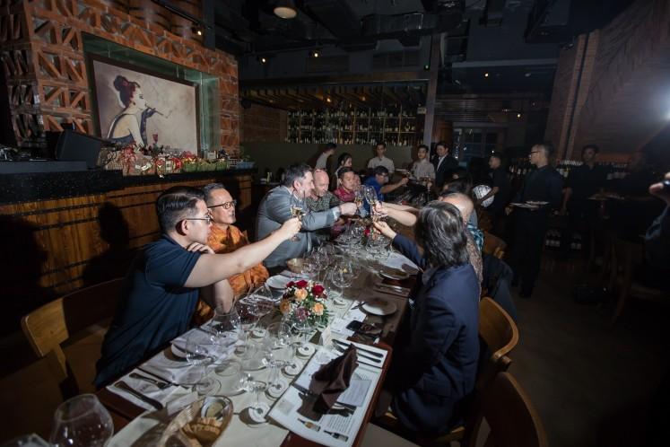 Wine connoisseurs enjoying Joseph Drouhin dinner at VIN+ Plaza Senayan Arcadia