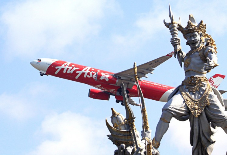 Flying high: An AirAsia aircraft takes off from Ngurah Rai International Airport.