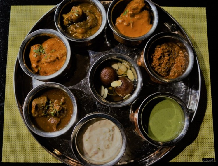 A 'thali' set is a traditional Indian service that comes complete with main courses, condiments and dessert on a single tray.