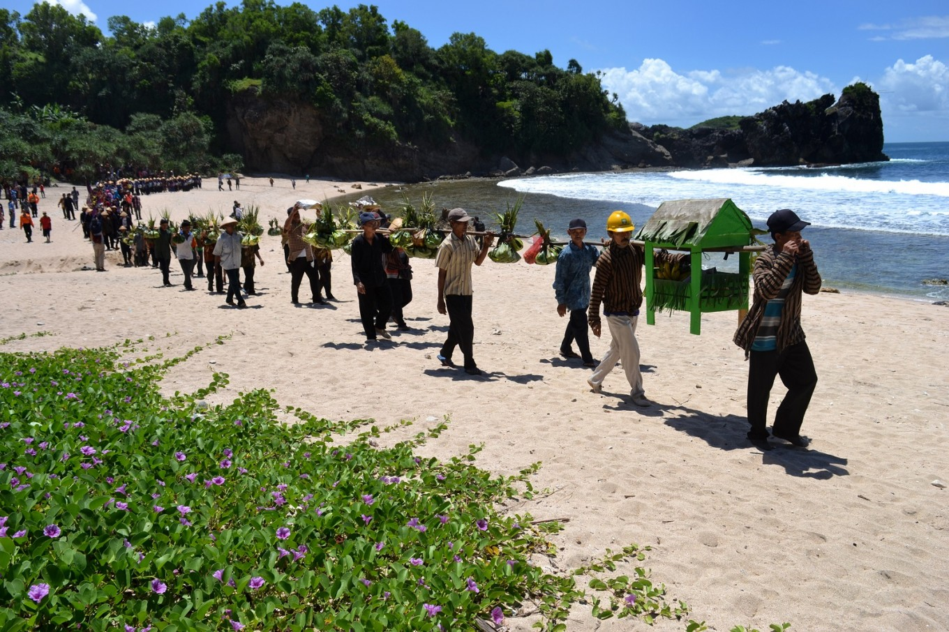 The village procession makes its way from Jungwok Beach to Wediombo Beach during the 'Sedekah Laut Ngalangi' thanksgiving cermony in Gunungkidul, Yogyakarta.
