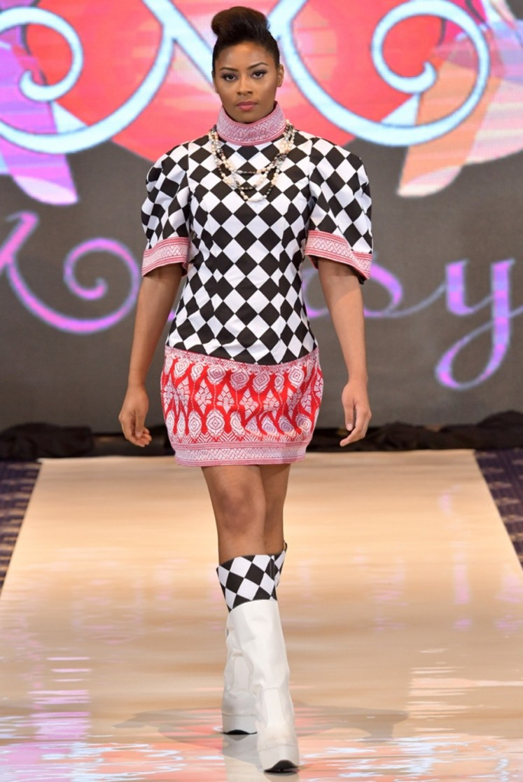 A model walks down the catwalk wearing one of the pieces from Anna Mariana's 'Babe' collection at DC Fashion Week.